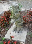 At the center of this garden area is this creepy statue. Is someone buried here?